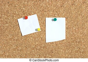 Corkboard - Blank papers pinned to a cork board