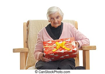 Happy grandmother - Portrait of an elderly woman holding a...