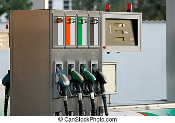 Fuel station - Closeup of four pumps at a petrol station