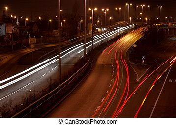 Night highway - Cars passing by on a highway at night