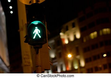 Green light - Green traffic light for pedestrians in a city...