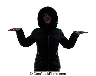 woman winter coat arms outstretched happy silhouette - one...