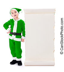 Little green Santa Claus standing near big wish list -...