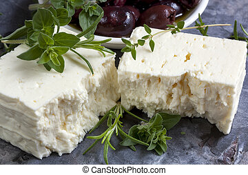 Feta Cheese with Black Olives and Fresh Herbs - Feta cheese...