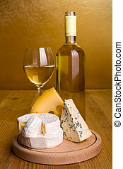 White wine with cheese snack - White wine in bottle and...