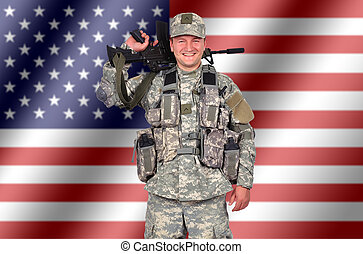 happy us soldier with his assault rifle on flag background