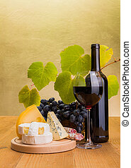 Red wine with grape and cheese snack - Red wine in bottle...