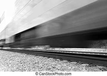 Train moving fast with motion blur. Black and white high-key...