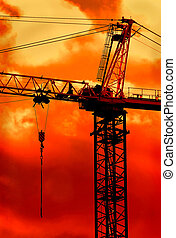 Crane Boom at Sunrise - Crane boom high in sky on a golden...