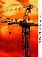 Crane Boom at Sunrise - Crane boom high in sky on a golden...