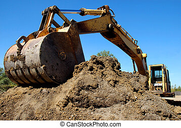 Construction Equipment - Crane digging foundation area for...