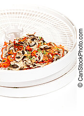 Dried vegetables on food dehydrator - Dried vegetables...