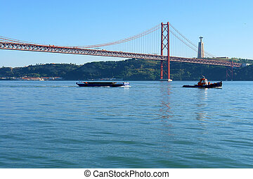 Famous old bridge over river Tejo - Lisbon, April 25th...