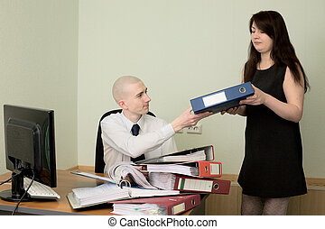 Bookkeeper and the secretary on a workplace - The bookkeeper...