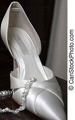 Shoe of the bride on her wedding day
