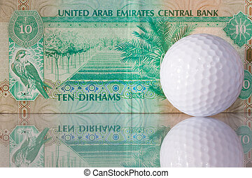 Dirhams and golf ball - Golf balls and money from Dubai