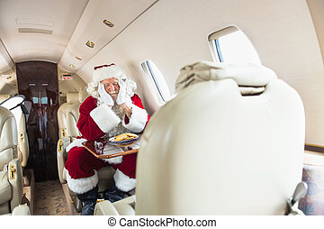 Santa With Head In Hands Sleeping In Private Jet - Man in...