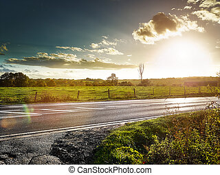 country road at sundown, cloudy backlite shot. peferct for...