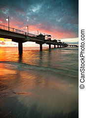 Pier in Sunset - Sunset over Baltic Sea and pier in...