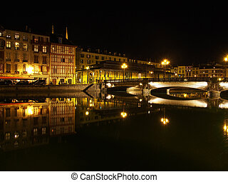 Bayonne, Nive riverside at night, France - Bayonne,...