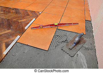 Home renovation, tiles - Home renovation tools, trowel and...