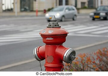 Hydrant - Red fire hydrant on a street