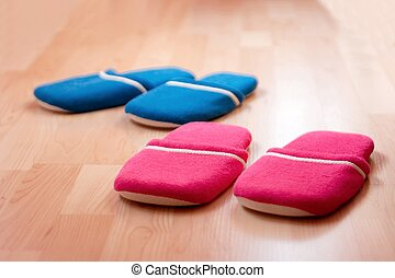 Slippers - Two pairs of slippers on the parquet