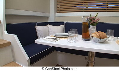 Table set for meal on a boat - Table set for meal, with blue...