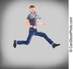 man jumping in air against - Portrait of an excited young...