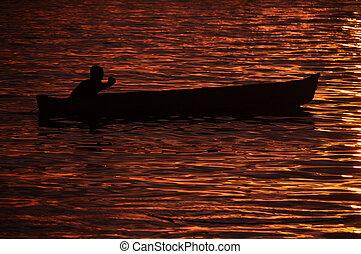 Fishermen on Canoe at Sunset