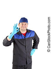 Worker with sign okey. Isolated on a white background.