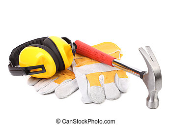 Protective ear muffs hammer and gloves Isolated on a white...