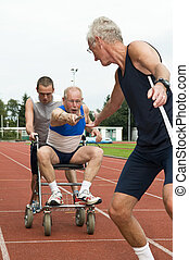 Reaching For The Baton - Disabled person and his helper...