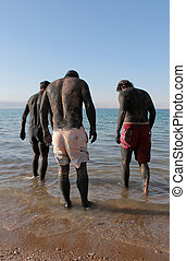 Man in Skin Mud Treatment At The Dead Sea, Jordan