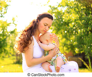 Beautiful Mother And Baby outdoors