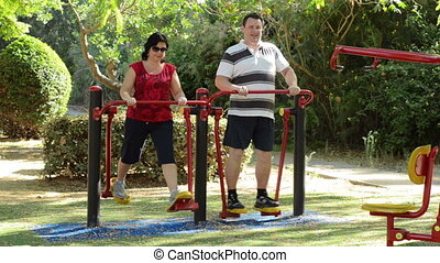 Couple on air walker outdoor - Couple improving aerobic...