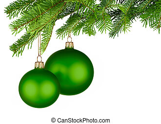 Green Christmas baubles hanging from fresh green twigs -...