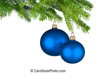 Blue Christmas baubles hanging from fresh green twigs -...