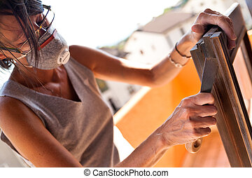 Woman polishing a window with a putty knife - Do it yourself...