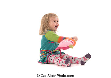 Happy baby sitting on the floor - Happy baby with toy...