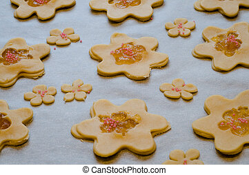 Cuted flowers from dough and decorated with jam