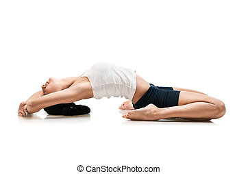 woman in supta virasana yoga position - adult woman in supta...