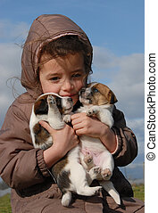 sad little girl and puppies - sad little girl and her...