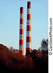 Striped Smoke Stacks - Colorful towering smoke stacks at...