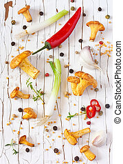 Chanterelle. - Chanterelle mushrooms and vegetables on a...
