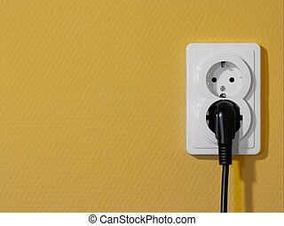 Socket - White electric socket on yellow wall