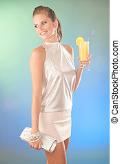 Cute young woman with cocktail