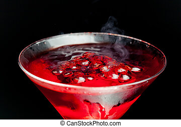 red cocktail with bubbles