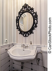 Vintage toilet with a mirror - Elegant white sink and oval...