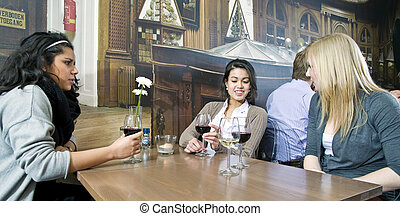 Girl Talk - Three women sitting at a table in a busy cafe